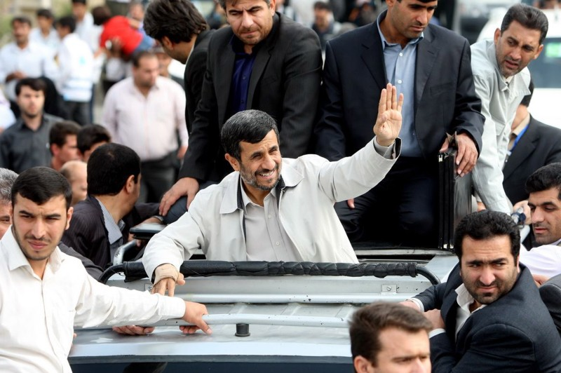 Mahmoud Ahmadinejad waves to members of the public from his car in the Presidential convoy on August 4, 2010 in Hamadan, Iran. (Photo by Iranian President's Office via Getty Images)