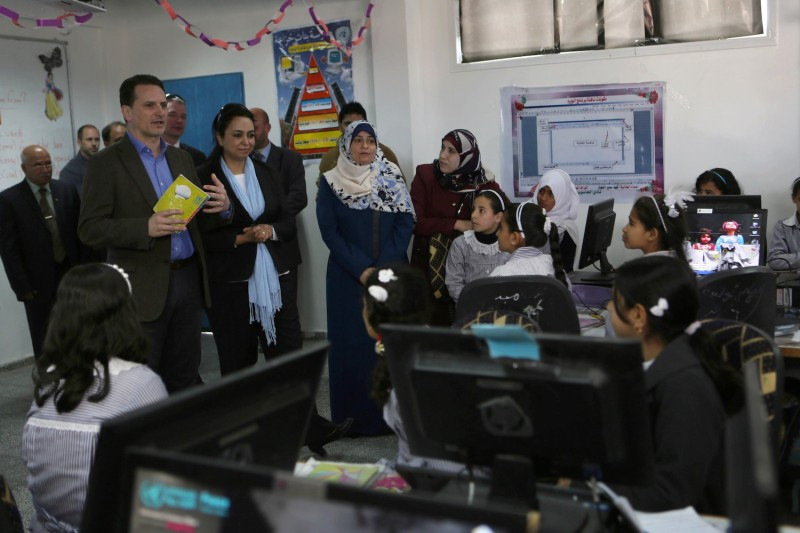 Pierre Krähenbühl, left, the commissioner-general of the United Nations Relief and Works Agency, meets with Palestinian students at a U.N.-run school in the southern Gaza Strip. (Said Khatib/AFP/Getty Images)