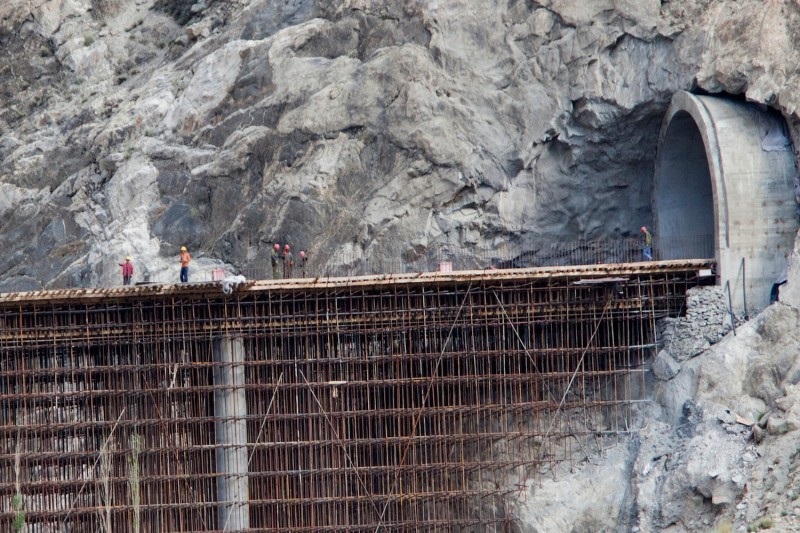 Chinese engineers work on the bridge and friendship tunnel connected to the  Karakoram highway in Pakistan on June 30, 2015.