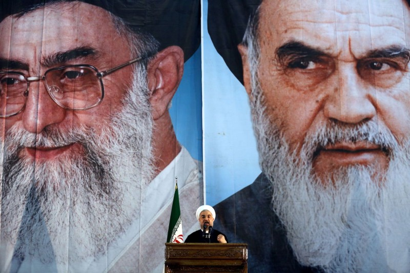Hassan Rouhani delivers a speech under portraits of Iran's supreme leader, Ayatollah Ali Khamenei, and the founder of the Islamic Republic, Ayatollah Ruhollah Khomeini, on  June 3, 2014. (Atta Kenare/AFP/Getty Images)