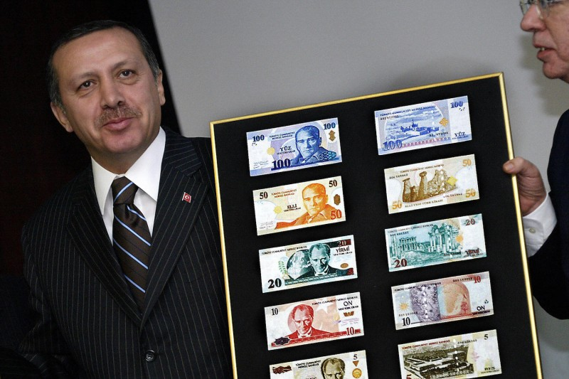 Turkish Prime Minister Recep Tayyip Erdogan displays the new Turkish lira in Ankara on October 25, 2004. (Tarik Tinazay/AFP/Getty Images)