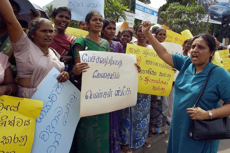 Sri Lankan women gather to demand peace talks between the government and Tamil Tiger rebels in Colombo on Dec. 10, 2004. (Sena Vidanagama/AFP/Getty Images)