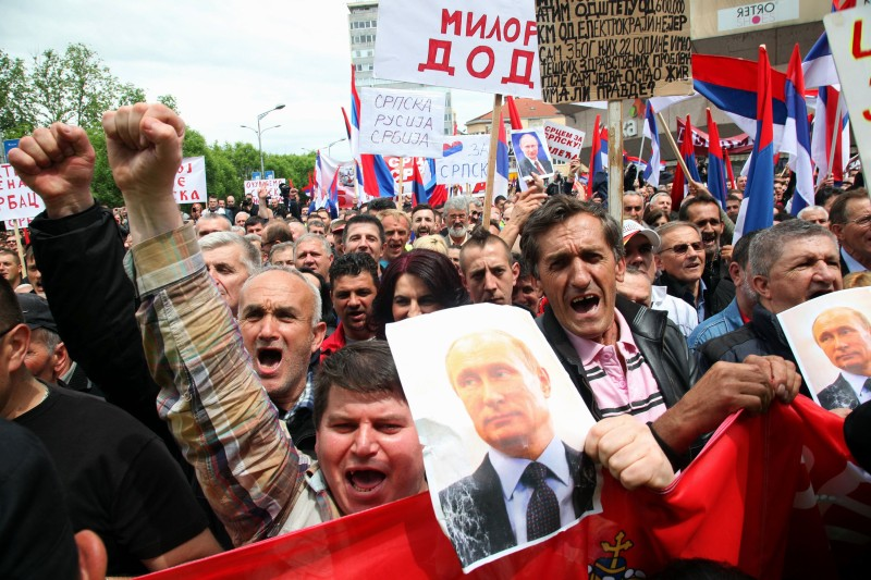 Bosnian Serb supporters of leftist parties hold up images of Russian President Vladimir Putin during a rally in support of the government in Banja Luka on May 14, 2016. (Elvis Barukcic/AFP/Getty Images)