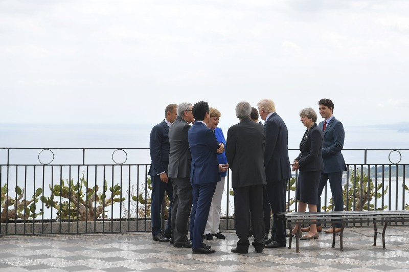 President of the European Council Donald Tusk, President of the European Commission Jean-Claude Juncker, Japanese Prime Minister Shinzo Abe, German Chancellor Angela Merkel, Italian Prime Minister Paolo Gentiloni, French President Emmanuel Macron (hidden), US President Donald Trump, Britain's Prime Minister Theresa May and Canadian Prime Minister Justin Trudeau chat at the belvedere of Taormina during the Heads of State and of Government G7 summit, on May 26, 2017 in Sicily. (MANDEL NGAN/AFP/Getty Images)