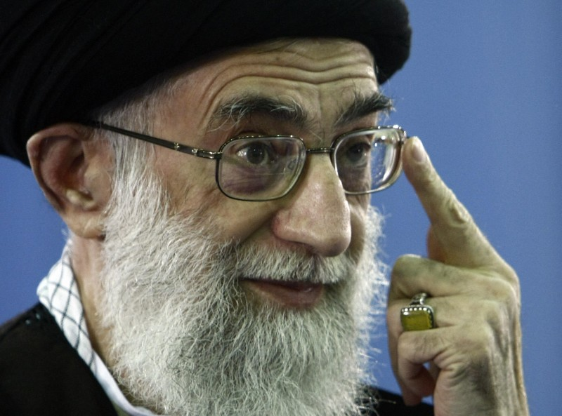 Iran's supreme leader, Ayatollah Ali Khamenei adjusts his eye glasses after voting at a polling station in Tehran on March 14, 2008. (BEHROUZ MEHRI/AFP/Getty Images)