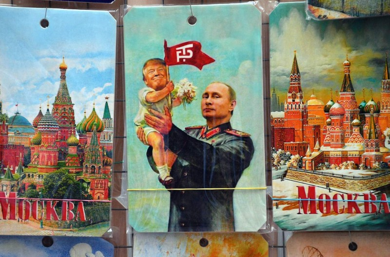 A souvenir kiosk in Moscow offers, among others things, a drawing depicting Russian President Vladimir Putin holding a baby with the face of U.S. President Donald Trump on July 5, 2017. (Mladen Antonovia/AFP/Getty Images)