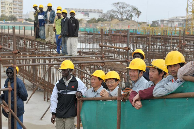 Seneglese and Chinese workers at the construction site for a new national theater in Dakar on Feb. 14, 2009. (Seyllou/AFP/Getty Images)