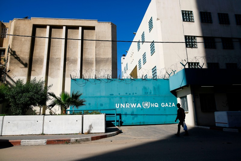 A Palestinian man walks past the building of the UNRWA headquarters in Gaza City on January 8, 2018. (MOHAMMED ABED/AFP/Getty Images)