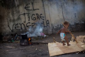 A Venezuelan refugee child walks inside a shelter in the city of Boa Vista, Roraima, Brazil, on February 24, 2018. (MAURO PIMENTEL/AFP/Getty Images)