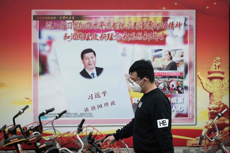 A propaganda poster showing China's President Xi Jinping is pictured on a wall in Beijing on March 12, 2018.  (NICOLAS ASFOURI/AFP/Getty Images)