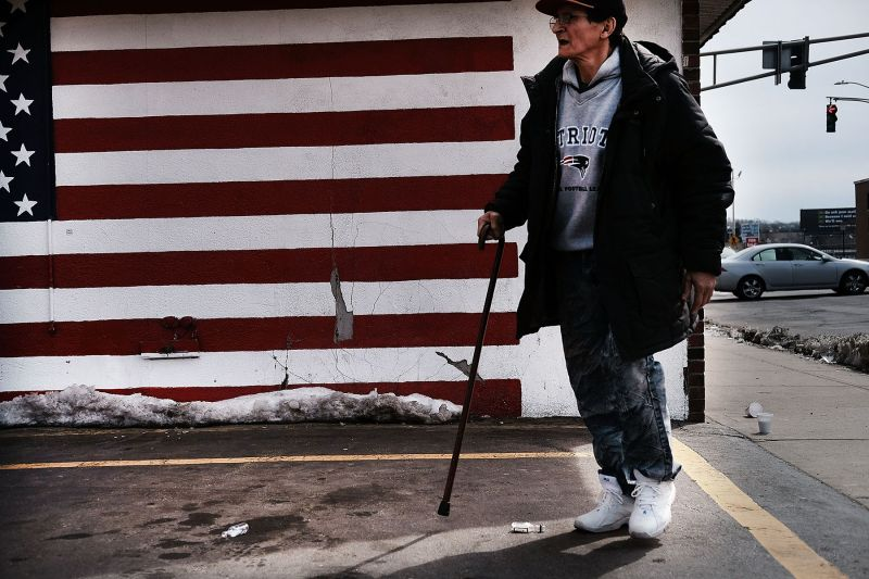 A man walks through an economically stressed section of Worcester, Massachusetts, on March 20. Data from 2016 indicated that 24.4 percent of Worcester residents were living below the poverty level. (Spencer Platt/Getty Images)