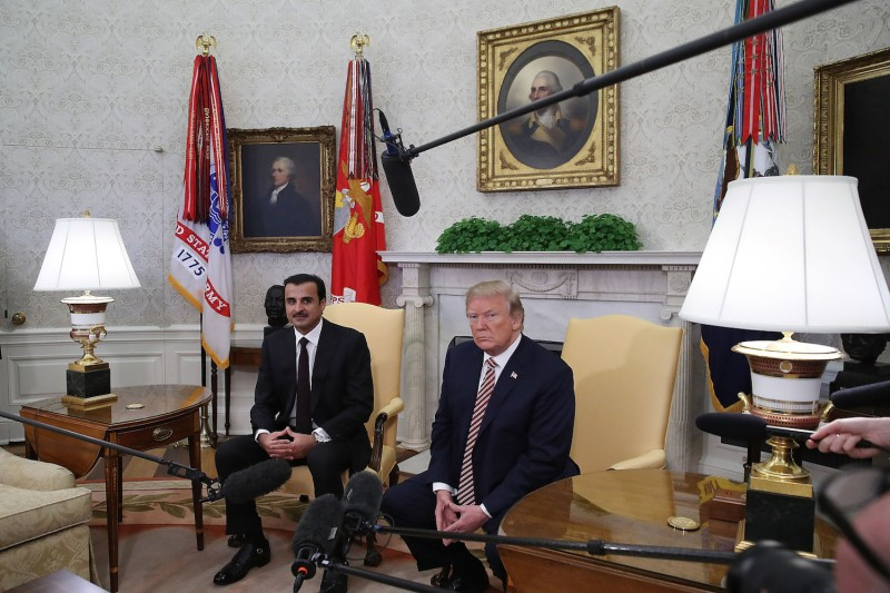 U.S. President Donald Trump meets with the Emir of Qatar Sheikh Tamim bin Hamad Al Thani, in the Oval Office at the White House on April 10.