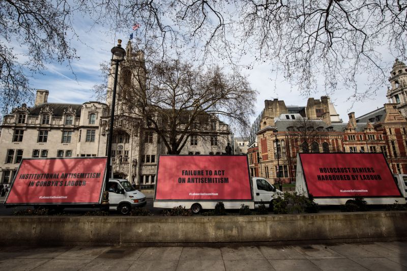 A convoy of billboard vans with messages against anti-semitism in the Labour Party are driven around Westminster on February 21, 2018 in London, England. (Photo by Jack Taylor/Getty Images)