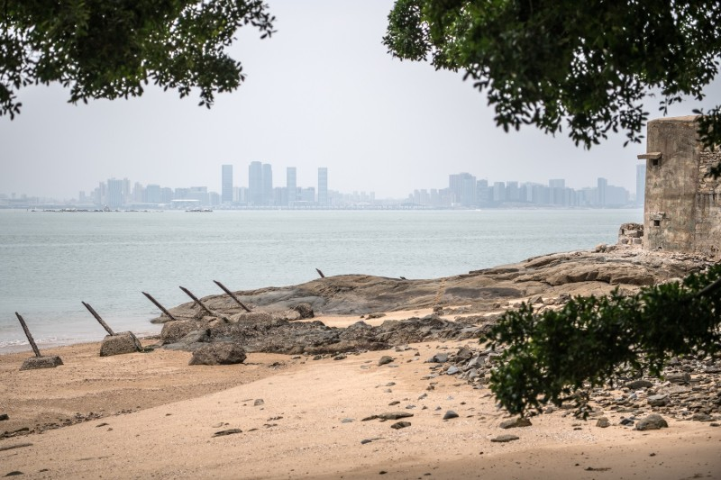 KINMEN COUNTY, TAIWAN - APRIL 20:  A concrete bunker overlooks the Chinese city of Xamen from the Taiwanese island of Little Kinmen which, at points lies only a few miles from China, on April 20, 2018 in Kinmen, Taiwan. China recently carried out live-fire military drills in the Taiwan Strait involving its Liaoning aircraft carrier, an exercise interpreted as a show of force and a message to self-governed Taiwan which China claims as its territory. The naval exercise was the first in the Taiwan Strait since 2016 and was held just over 100 miles off the coast of Taiwan. Following the defeat of the ruling Kuomintang party by the Chinese Communist Party and their retreat to Taiwan in 1949, cross-strait relations have varied from open conflict to diplomatic war. China's President, Xi Jinping, recently emphasised China's sovereignty over Taiwan by stating that 'We have sufficient abilities to thwart any form of Taiwan independence attempts'. Beijing has also imposed financial restrictions by significantly limiting the number of Chinese tour groups allowed to visit Taiwan and imposed trade sanctions on the island.  (Photo by Carl Court/Getty Images)