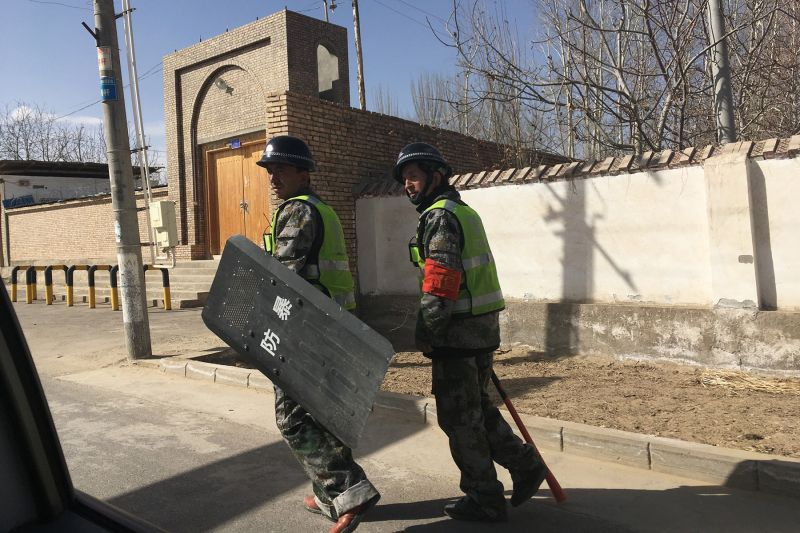 Local police patrol a village in Hotan prefecture, in China's western Xinjiang region, on Feb. 17. The predominantly Uighur area has become one of the most policed places in the world. (Ben Dooley/AFP/Getty Images)