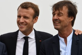 French president Emmanuel Macron (L) poses for photographs with Minister for the Ecological and Inclusive Transition Nicolas Hulot on June 20, 2018 during a visit to Cap Frehel in Plevenon, western France. (FRED TANNEAU/AFP/Getty Images)