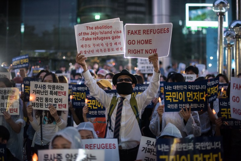 Anti-immigration activists attend a protest against a group of asylum-seekers from Yemen, in Seoul on June 30, 2018. (ED JONES/AFP/Getty Images)