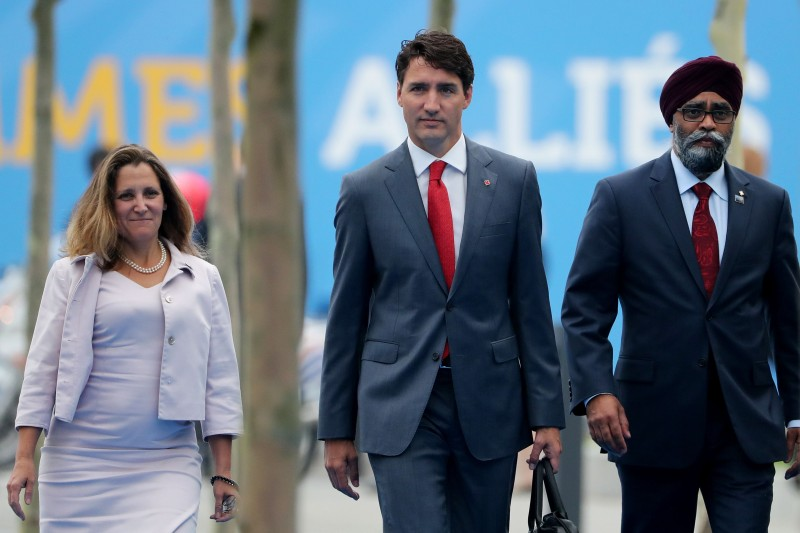 Canada's Foreign Minister Chrystia Freeland, Canadian Prime Minister Justin Trudeau and Canadian Defence Minister Harjit Sajjan arrive to attend the North Atlantic Treaty Organization (NATO) summit in Brussels on July 12, 2018. (TATYANA ZENKOVICH/AFP/Getty Images)
