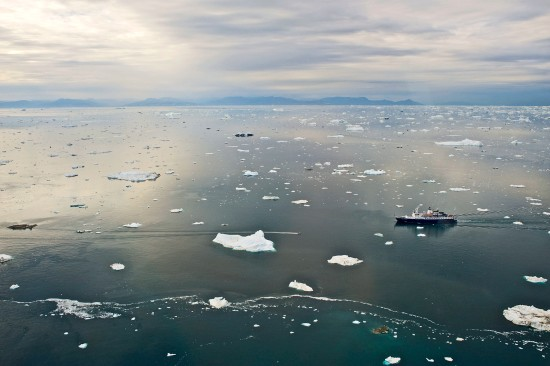A cruise ship near the harbor of Ilulissat off the west coast of Greenland, north of the Arctic Circle, in August 2012. (Education Images/UIG via Getty Images)