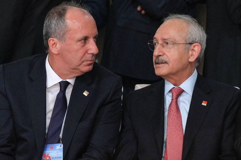 The chairman of Turkey's  Republican People's Party (CHP), Kemal Kilicdaroglu (R), speaks with Muharrem Ince (L), as they attend the Party's 36th ordinary congress in Ankara, on February on 3, 2018.