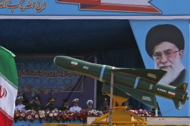 An Iranian military truck carries missiles past a portrait of Iran's Supreme Leader Ayatollah Ali Khamenei during a parade on the occasion of the country's annual army day on April 18, 2018 in Tehran.