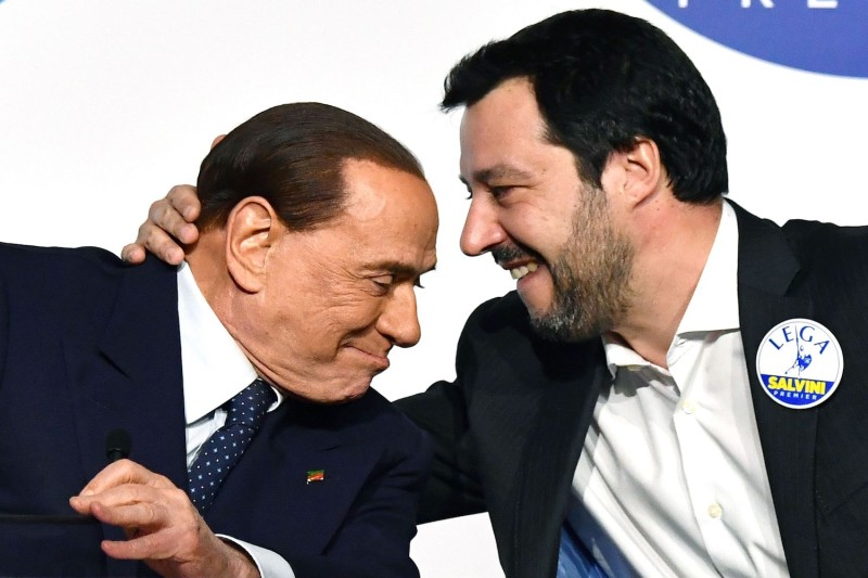 The leader of the far-right League party, Matteo Salvini (R), embraces Silvio Berlusconi during a joint press conference in Rome on March 1, 2018.
