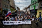 "Protesters hold a banner reading ""Stand up for decent Slovakia"" during a protest in Bratislava, Slovakia, on June 22, 2018, four months after the murder of journalist Jan Kuciak and his fiancee."