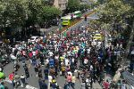 Iranians take to the streets protesting the country's economic woes and the government in Tehran on June 25. (Atta Kenare/AFP/Getty Images)