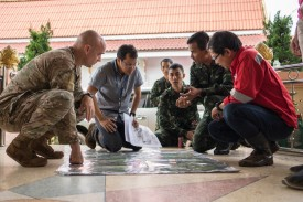 U.S. Air Force Maj. Charles Hodges (left) and airmen from the U.S. Indo-Pacific Command meet with Royal Thai military officials and a Thai engineering company to advise and assist in the rescue operation at the Tham Luang cave system on June 30. (U.S. Air Force photo by Capt. Jessica Tait)