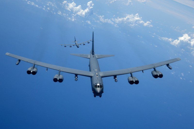 Two U.S. Air Force B-52H Stratofortress bombers fly over the Pacific Ocean during a routine training mission on Aug. 2. (U.S. Air Force photo by Airman 1st Class Gerald R. Willis)
