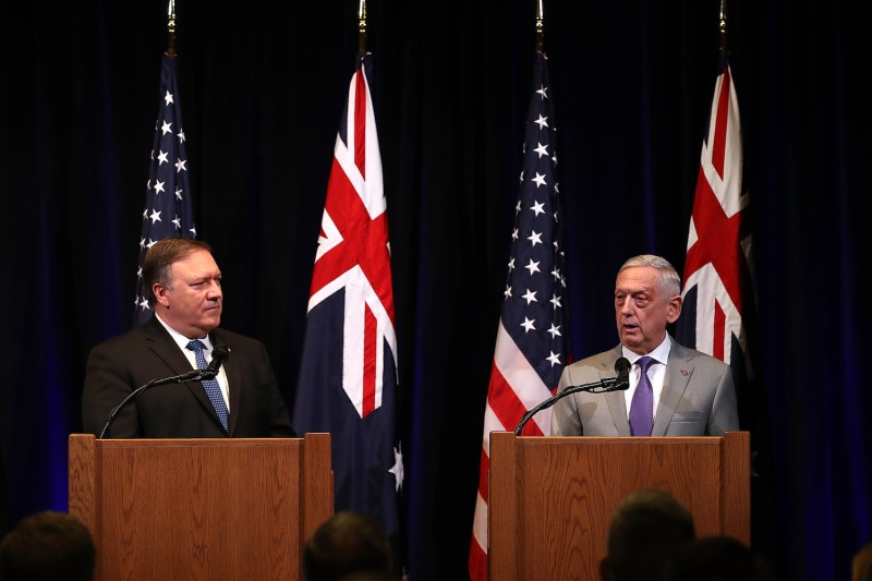 U.S. Secretary of State Mike Pompeo looks on as U.S. Secretary of Defense James Mattis speaks during a press conference at the Australia-U.S. Ministerial Consultations at the Hoover Institution on the campus of Stanford University on July 24, 2018 in Stanford, California. Justin Sullivan/Getty Images