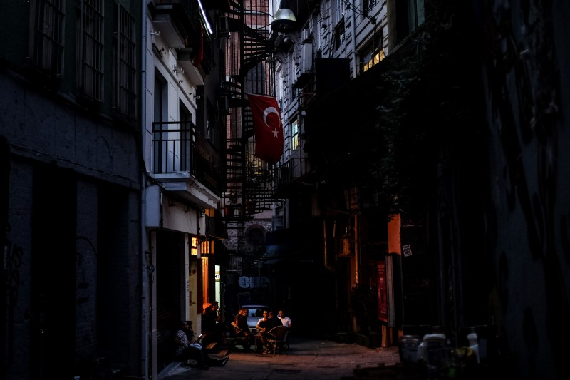 People eat and drink in a street on August 15, 2018 in Istanbul, Turkey. (Chris McGrath/Getty Images)