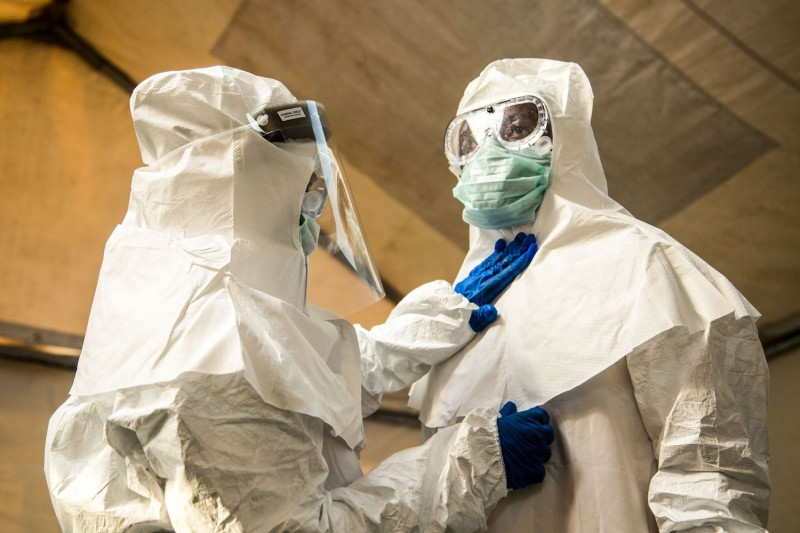 Medical staff check each other's protective suits before entering the isolation unit at a hospital in Bundibugyo, western Uganda, during a suspected case of Ebola. Aug. 17. (Sumy Sadurni /AFP/Getty Images)