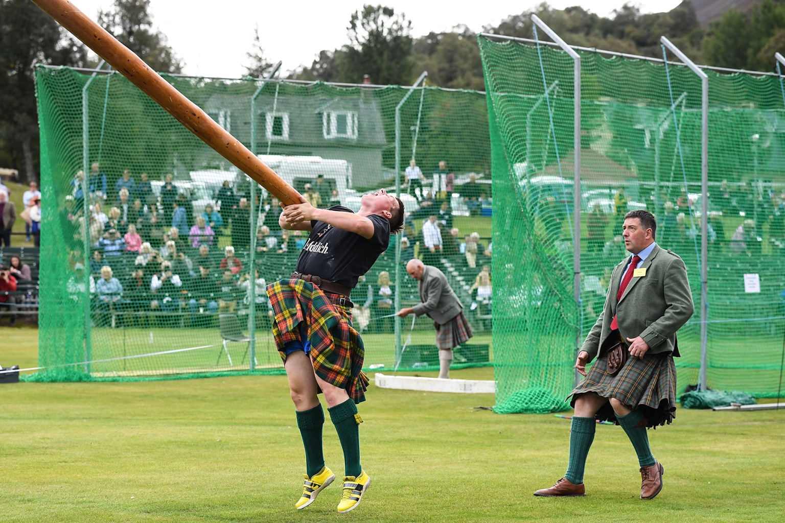 Competitors take part at the Braemer Highland Games at The Princess Royal and Duke of Fife Memorial Park in Braemar, Scotland, on Sept. 1. Each year thousands of visitors descend on this small village to watch one of the more colorful Scottish traditions. Jeff J Mitchell/Getty Images