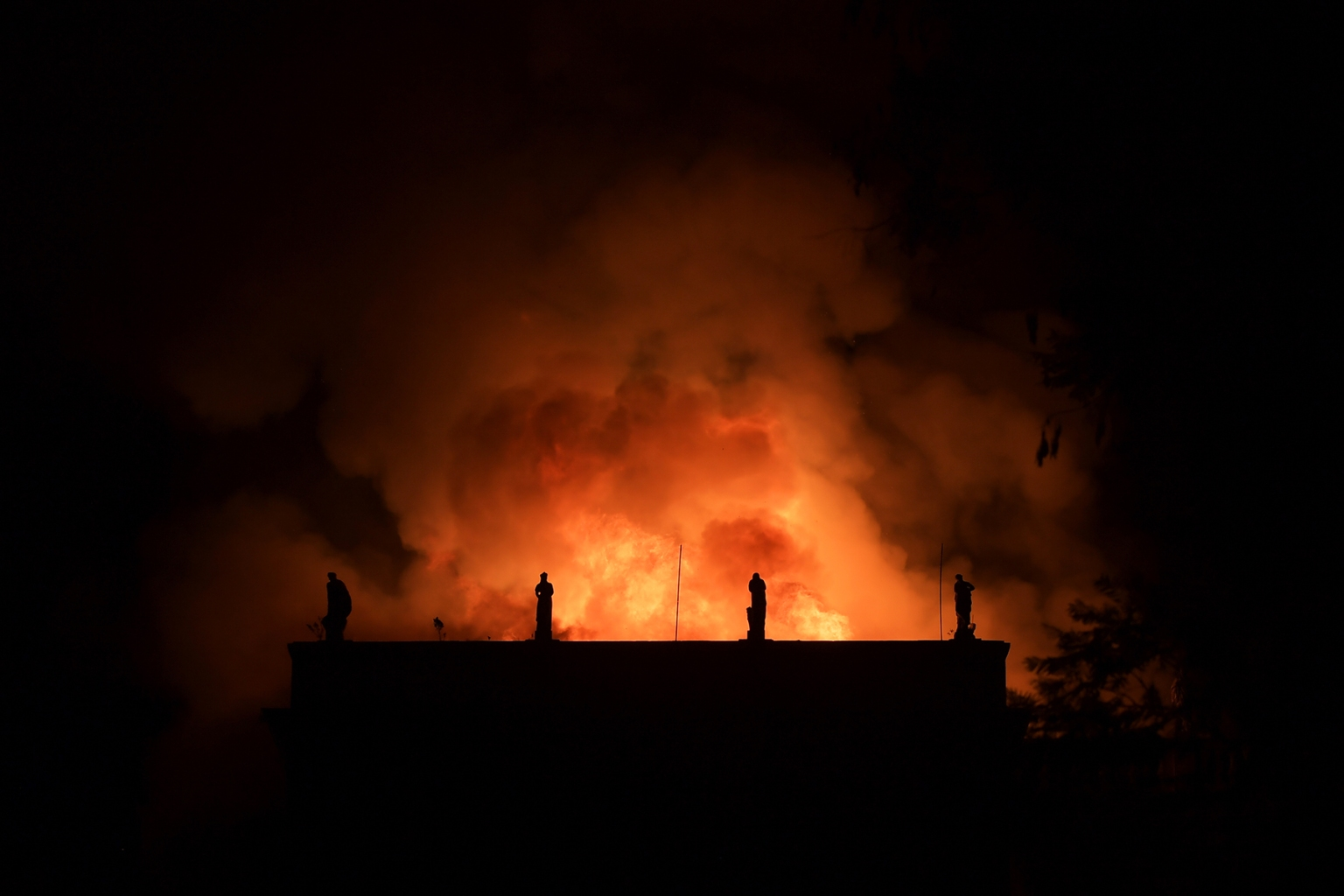 A massive fire engulfs the National Museum in Rio de Janeiro on Sept. 2. The magestic edifice was home to more than 20 million valuable pieces, including art and artifacts from Greco-Roman times and Egypt as well as from Brazil and the rest of Latin America. CARL DE SOUZA/AFP/Getty Images