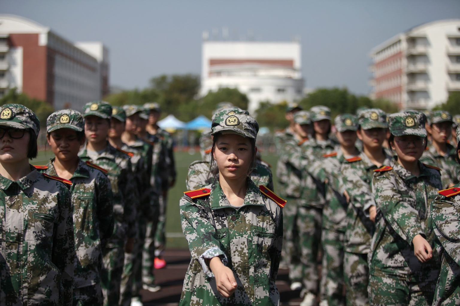 University freshmen take part in a military education and drill session at the beginning of the new semester in Yangzhou in China's eastern Jiangsu province on Sept. 4. STR/AFP/Getty Images