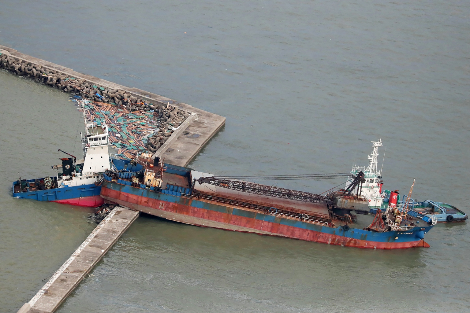 A ship breaks apart after crashing into a breakwater during strong winds from typhoon Jebi in Nishinomiya city, Hyogo prefecture, Japan, on Sept. 5. JIJI PRESS/AFP/Getty Images