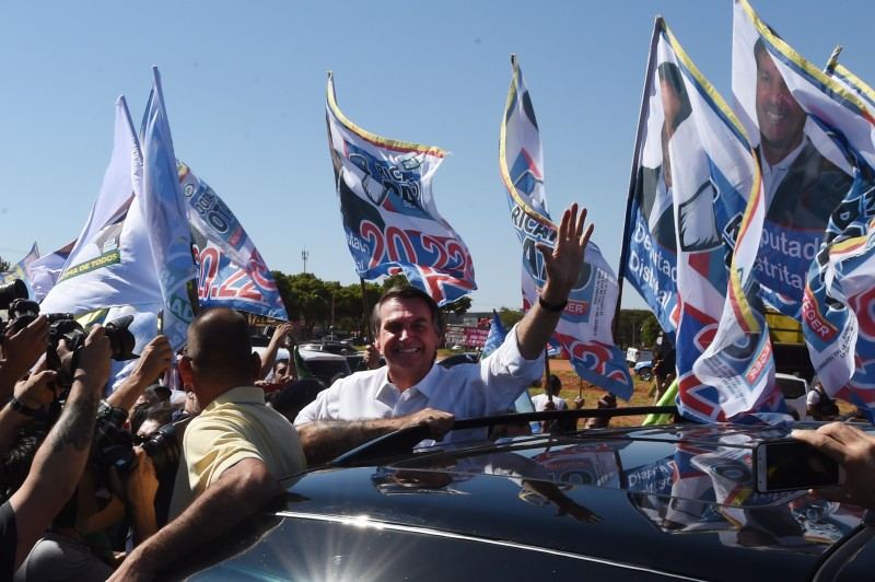 Bolsonaro waves at the crowd during a campaign rally in the district of Ceilandia in Brasilia, on September 5, 2018. (Evaristo SA/FP/Getty Images)