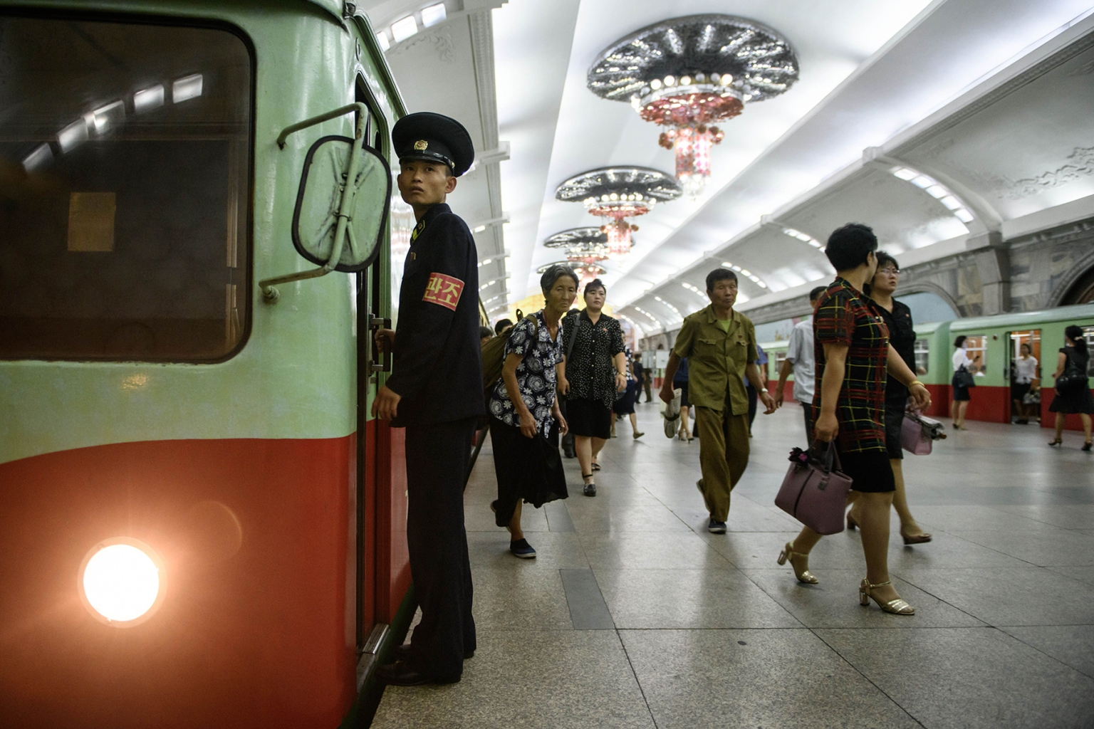 Commuters make their way through a subway station of the Pyongyang metro on Sept. 6. ED JONES/AFP/Getty Images