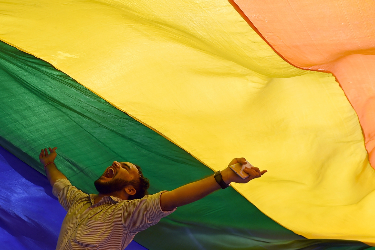 A member of the LGBT community celebrates in Mumbai after the Supreme Court decision to strike down a colonial-era ban on gay sex in India on Sept. 6. INDRANIL MUKHERJEE/AFP/Getty Images