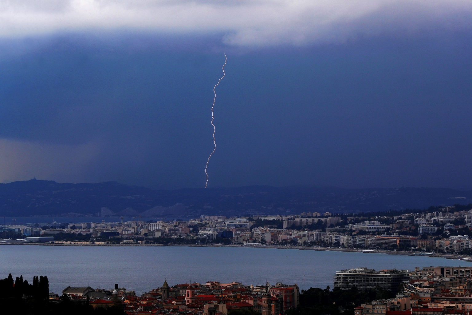 A flash of lightning strikes above the Baie des Anges in the French riviera city of Nice, southeastern France, on Sept. 6. VALERY HACHE/AFP/Getty Images
