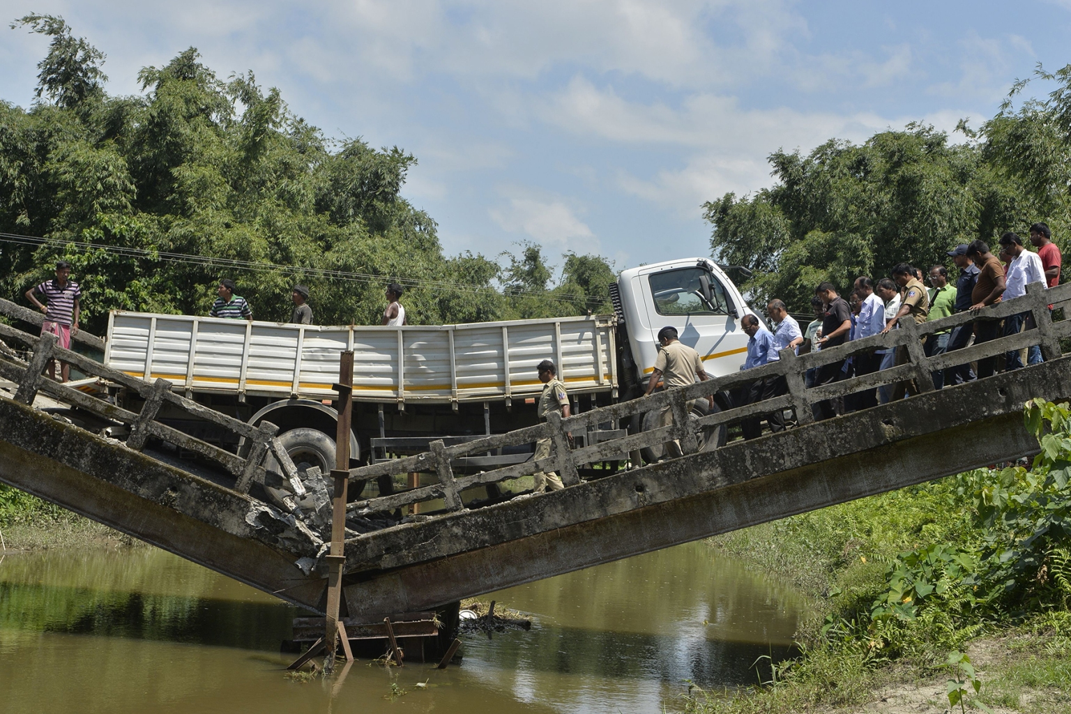 Rescue workers and villagers gather near a collapsed bridge in Phasidewa village near the India-Bangladesh border in the Indian state of West Bengal on Sept. 7. No casualties were reported in the collapse. DIPTENDU DUTTA/AFP/Getty Images