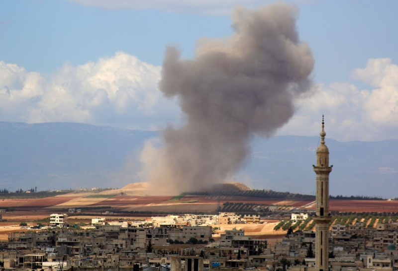 Smoke rises in the Syrian village of Kafr Ain in the southern countryside of Idlib province after an airstrike on Sept. 7. (Anas al-Dyab/AFP/Getty Images)