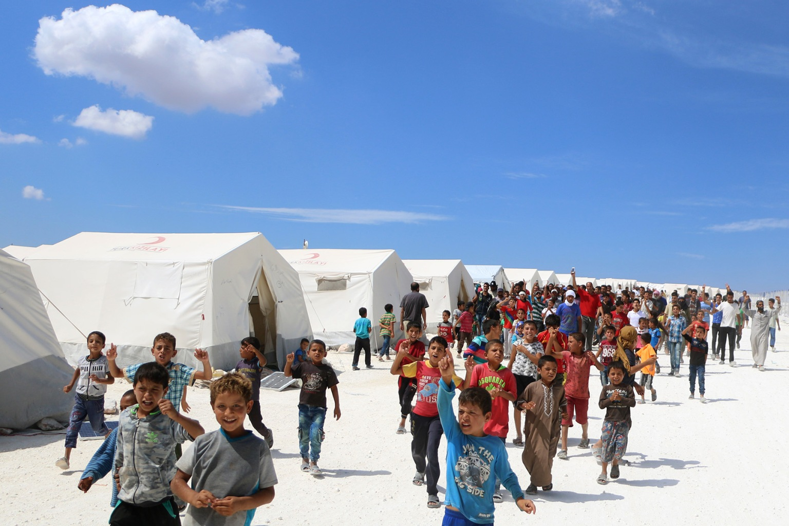 Displaced Syrians take part in a protest against the regime and its ally Russia at a camp for displaced people in Kafr Lusin near the Bab al-Hawa border crossing with Turkey in Syria's northern Idlib province on Sept. 7. AAREF WATAD/AFP/Getty Images