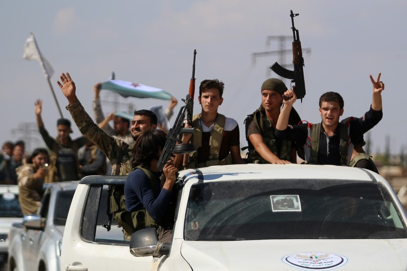 Syrian rebel fighters in the northern countryside of Idlib province on Sept. 11. (Aaref Warad/AFP/Getty Images)