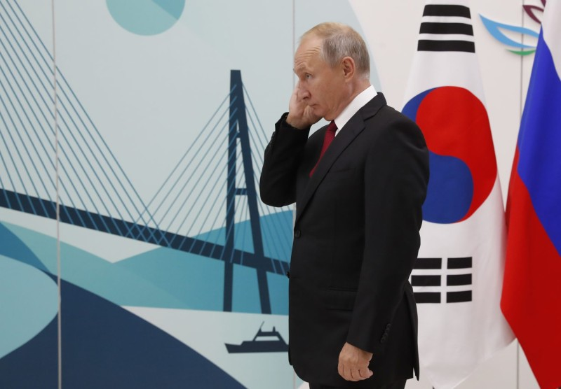 Russian President Vladimir Putin waits to greet the South Korean prime minister ahead of their meeting on the sidelines of the Eastern Economic Forum in Vladivostok, Russia, on Sept. 12. (Sergei Chirikov/AFP/Getty Images)