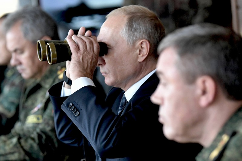 Russia's President Vladimir Putin, Defense Minister Sergei Shoigu, and Chief of the General Staff of the Russian Armed Forces Valery Gerasimov watch the Vostok-2018 military drills at Tsugol training ground not far from the Chinese and Mongolian border in Siberia, on September 13, 2018. ALEXEY NIKOLSKY/AFP/Getty Images