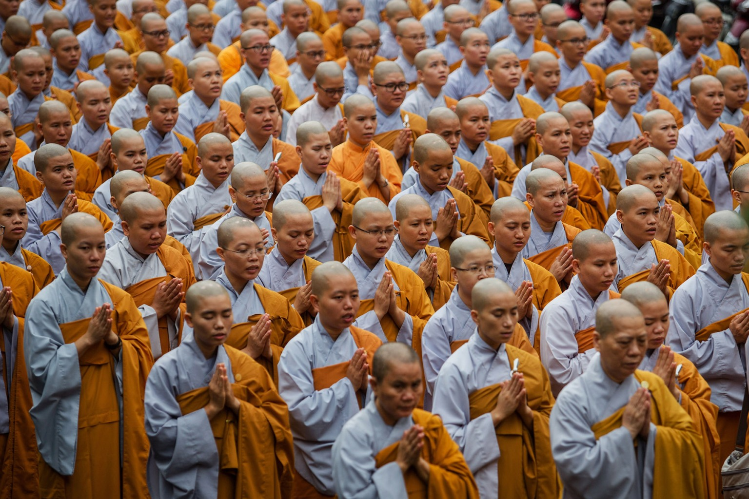 Buddhist monks pray for President Tran Dai Quang, who died Sept. 21 at age 61, at the Viet Nam Quoc Tu Pagoda in Ho Chi Minh City on Sept. 23.  KAO NGUYEN/AFP/Getty Images