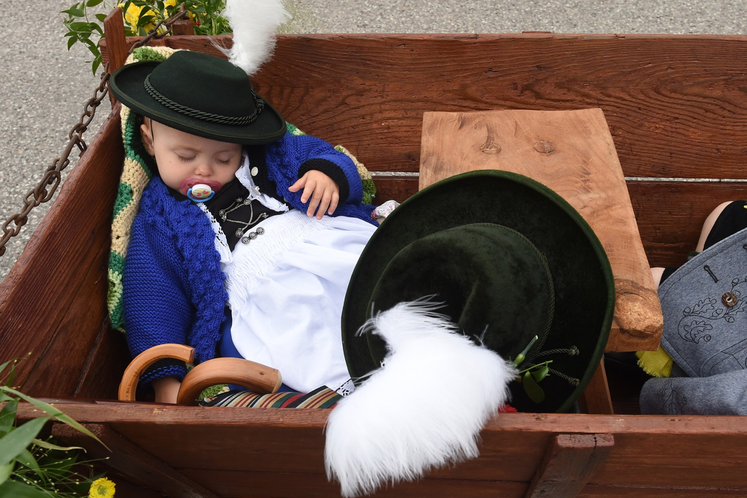 A child sleeps in a cart during the traditional costume and riflemen parade on the second day of the Oktoberfest beer festival in Munich, Germany, on Sept. 23. The world's biggest beer festival runs until Oct. 7. CHRISTOF STACHE/AFP/Getty Images