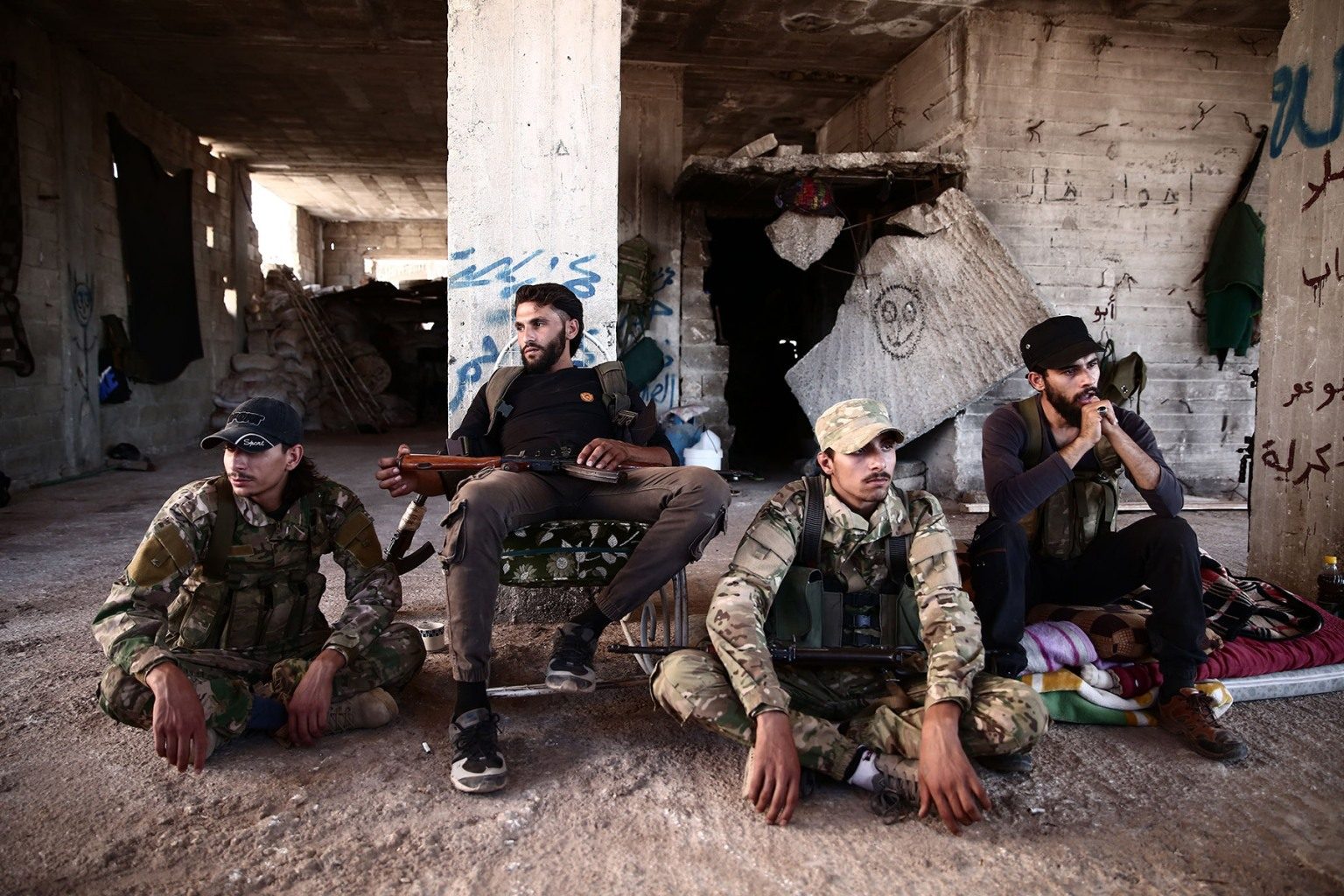 Fighters from the Nureddine al-Zinki unit, a moderate Syrian opposition faction affiliated with the Muslim Brotherhood, rest in a rebel-held part of Aleppo province on Sept. 23. NAZEER AL-KHATIB/AFP/Getty Images
